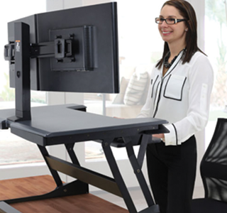 Worker using Ergotron Sit-Stand Computer