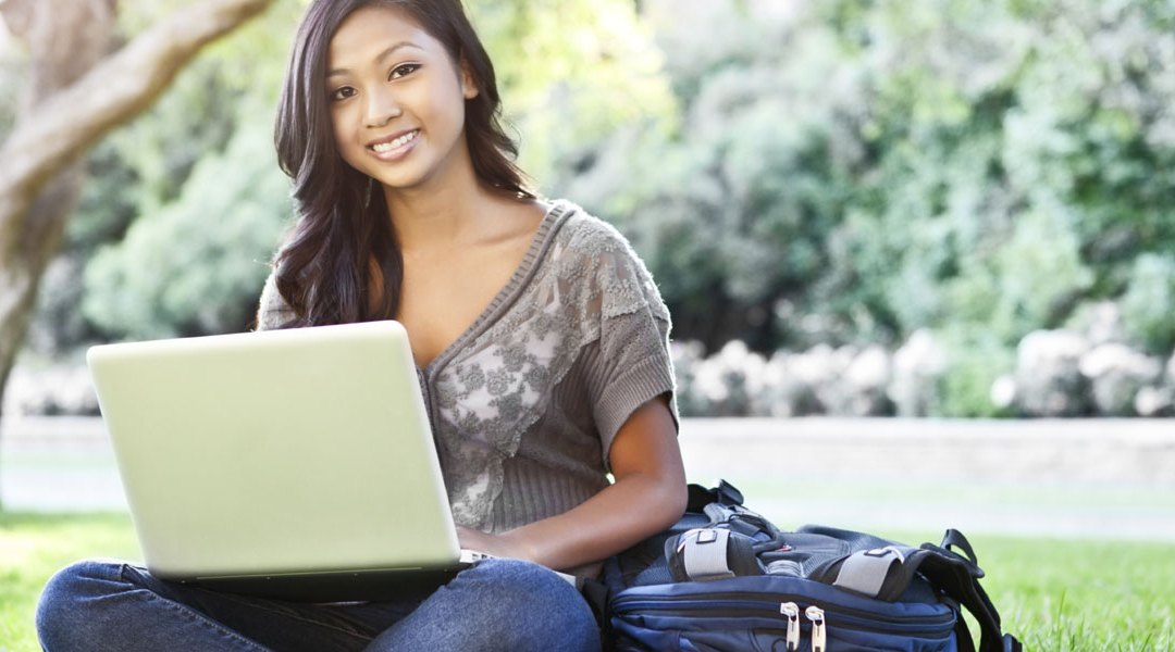 young-female-college-student-on-laptop